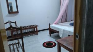 A bed or beds in a room at Samadhi Guest Inn Ella