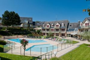The swimming pool at or near Mercure Bayeux Omaha Beach