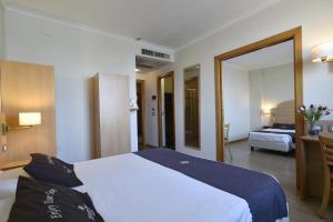 Letto o letti in una camera di Tulip Inn Turin West Rivoli