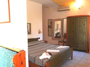 A bed or beds in a room at Locanda Ca Dei Duxi