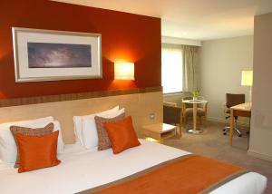 A bed or beds in a room at Cambridge Bar Hill Hotel, BW Signature Collection