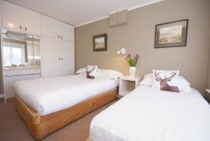 A bed or beds in a room at Lios Na Manach Farmhouse B&B