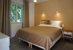 A bed or beds in a room at Villa hortensia