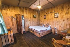 A bed or beds in a room at Munlom Nature Resort