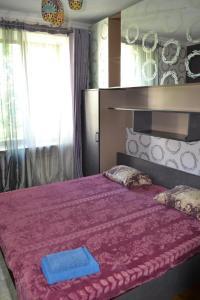 Кровать или кровати в номере Furnished Apartments on Universitet
