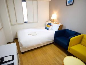 A bed or beds in a room at Smile Hotel Atsugi
