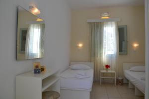 Ένα ή περισσότερα κρεβάτια σε δωμάτιο στο Galaxy Hotel
