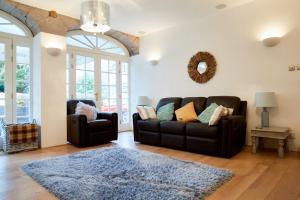 A seating area at Centre Stables Luxury Self Catering Cottage