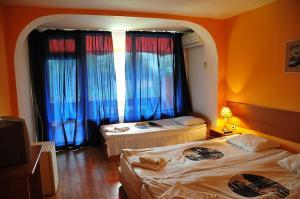 Легло или легла в стая в Хотел Сърф