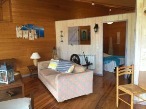 A bed or beds in a room at Chalet de charme & Séjour Bien-Etre