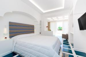 A bed or beds in a room at Quattro Passi Relais