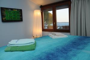 Letto o letti in una camera di Appartamento Sabatinus