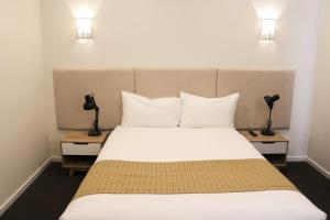 A bed or beds in a room at Rowville International Hotel