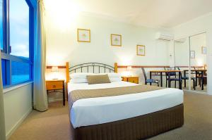 A bed or beds in a room at at Whitsunday Vista Holiday Apartments