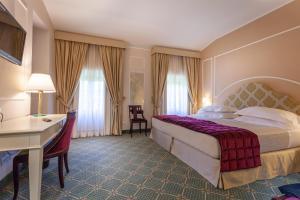 Ein Bett oder Betten in einem Zimmer der Unterkunft Hotel Villa San Lucchese