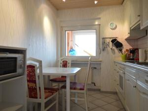 A kitchen or kitchenette at Cozy Apartment with Private Swimming Pool in Wuppertal