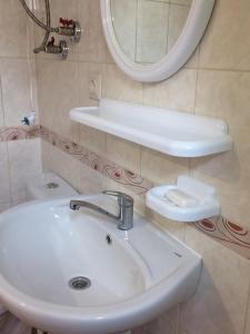A bathroom at Дом семейного отдыха
