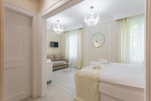 Un ou plusieurs lits dans un hébergement de l'établissement Boutique Hotel Bačvice