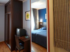 A bed or beds in a room at Hotel Rico