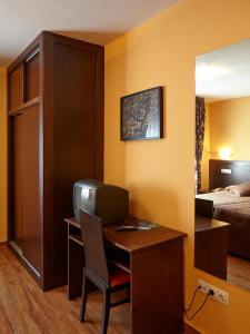A television and/or entertainment center at Hotel Rico