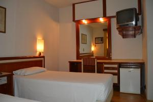 A bed or beds in a room at Braston Augusta