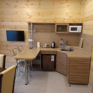 A kitchen or kitchenette at Guest complex Bereg