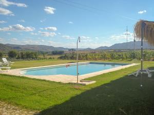 The swimming pool at or near Casa do Caseiro