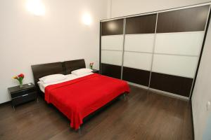 A bed or beds in a room at Ekaterina II Hotel