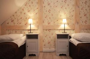 Łóżko lub łóżka w pokoju w obiekcie Pensjonat Sielanka