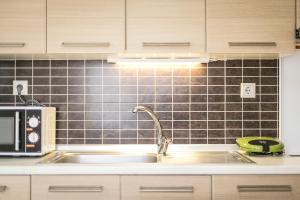 A kitchen or kitchenette at Olive Tree Apartments