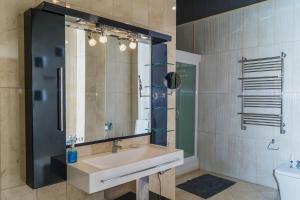 Ванная комната в Апартаменты Гранд Стадион