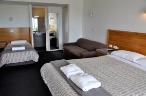 A bed or beds in a room at A Great Ocean View Motel