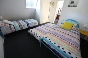 A bed or beds in a room at Adalene at South West Rocks