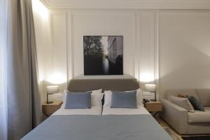 A bed or beds in a room at BoHo Prague Hotel - Small Luxury Hotels