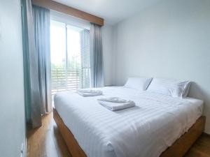 Кровать или кровати в номере Baan View Viman