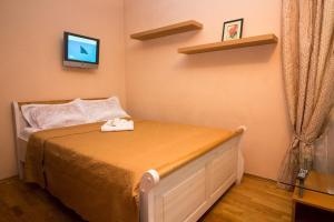 Кровать или кровати в номере Апартаменты на Филевском парке