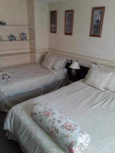A bed or beds in a room at Langport Arms Hotel