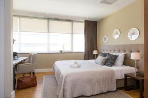 Кровать или кровати в номере Boutique Hotel Lumiere