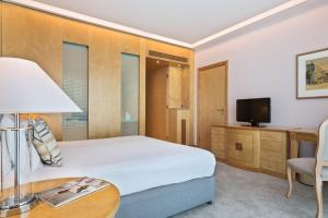 A bed or beds in a room at Melia Athens
