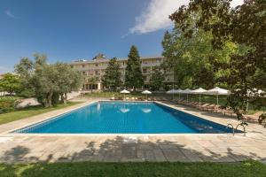 The swimming pool at or near Divani Meteora Hotel