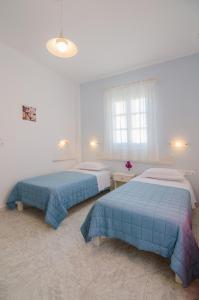 Ένα ή περισσότερα κρεβάτια σε δωμάτιο στο Athena Rooms