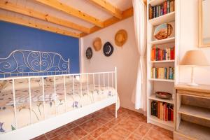 A bed or beds in a room at Villa Galanis