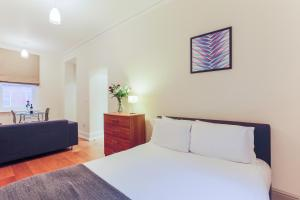 A bed or beds in a room at Leicester Square One