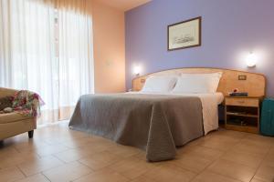 Кровать или кровати в номере Hotel Torricella