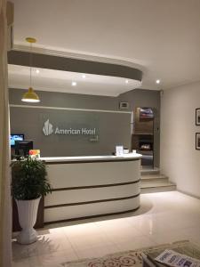 O saguão ou recepção de American Hotel