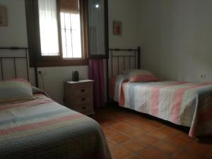 Cama o camas de una habitación en Casa Rural Aya I