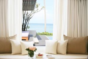 A seating area at Celes Beachfront Resort - Koh Samui