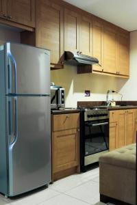 A kitchen or kitchenette at Crosswinds Resort Suites