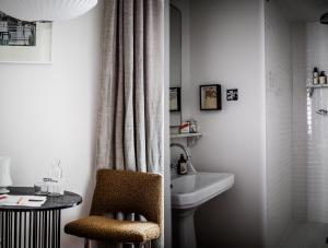 A bathroom at Le Pigalle Hotel