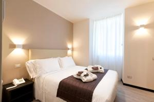 A bed or beds in a room at Hotel Villa Cipressi, by R Collection Hotels